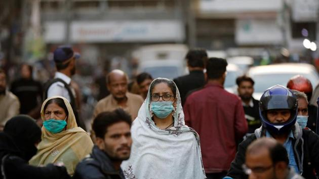 Women wear protective masks as they walk through a crowd along a market as the outbreak of the coronavirus disease (Covid-19) continues, in Karachi, Pakistan.(Reuters)