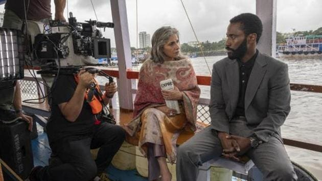Dimple Kapadia and John David Washington on the set of Tenet.