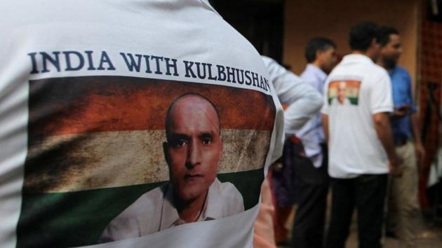 People wait before the issue of a verdict in the case of Kulbhushan Jadhav by International Court of Justice, in Mumbai, on July 17, 2019.(Reuters file)