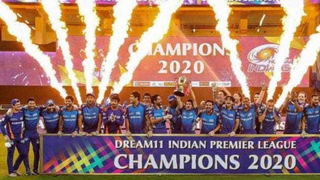 Mumbai Indians team pose with the winners trophy after winning the final cricket match of the Indian Premier League (IPL) T20 against Delhi Capitals, at Dubai International Cricket Stadium in Dubai.(PTI)