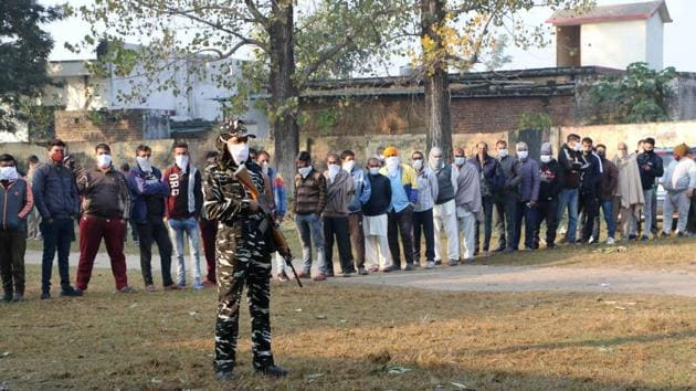 Voters wait in a queue to cast their votes for the third phase of the District Development Council (DDC) elections, at Gajansu Village in Jammu on December 4.(PTI)