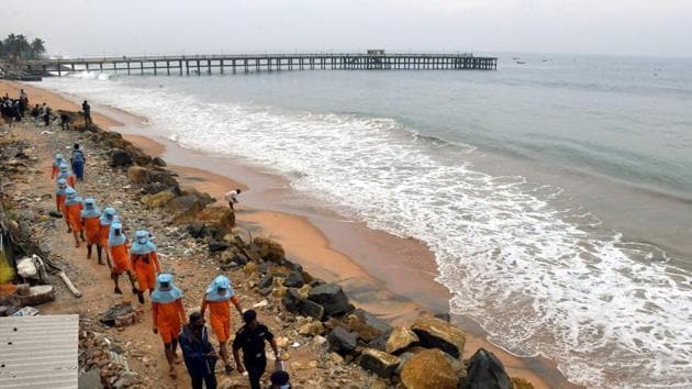 A team of the National Disaster Response Force (NDRF) arrives at a seashore of Valiyathura as part of the preparedness ahead of Cyclone Burevi in Thiruvananthapuram.(PTI Photo)