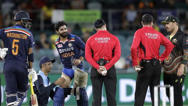 India's Ravindra Jadeja, third left, has a trainer tend to his leg during a break in batting against Australia during their T20 international cricket match at Manuka Oval, in Canberra, Australia.(AP)