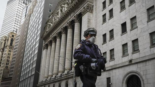 An NYPD officer walks along a sparsely populated Wall Street in the Manhattan borough of New York.(Representational Image / AP)
