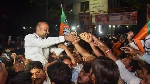Telangana state BJP President Bandi Sanjay Kumar along with other party workers celebrate the Greater Hyderabad Municipal Corporation (GHMC) election results in Hyderabad on Friday.(PTI photo)