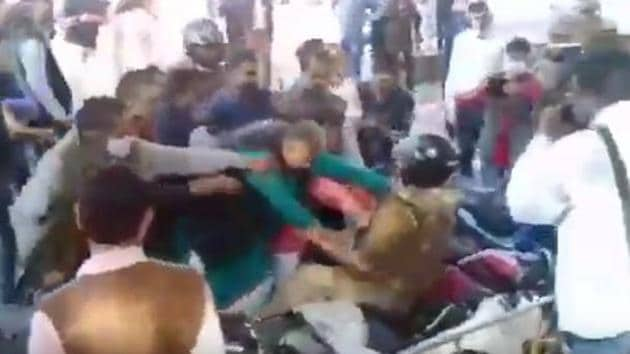 BJP leaders were accused of manhandling Jhansi superintendent of police during counting of votes for Allahabad-Jhansi division graduates' constituency seat.(Courtesy- Twitter)
