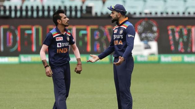 India's captain Virat Kohli, right, talks to bowler Yuzendra Chahal during the one day international cricket match between India and Australia at the Sydney Cricket Ground in Sydney.(AP)