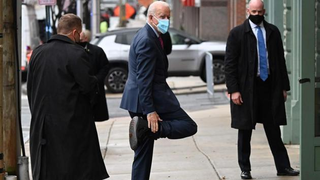 US President-elect Joe Biden playfully shows off his boot as he arrives at The Queen in Wilmington, US.(AFP)