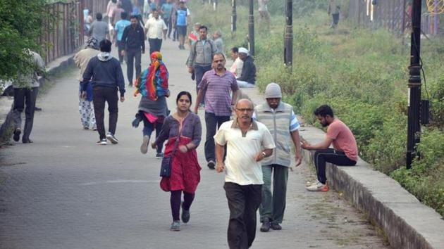 People walk on a winter morning at Vadgaon on Sinhgad road in Pune.(HT File Photo)