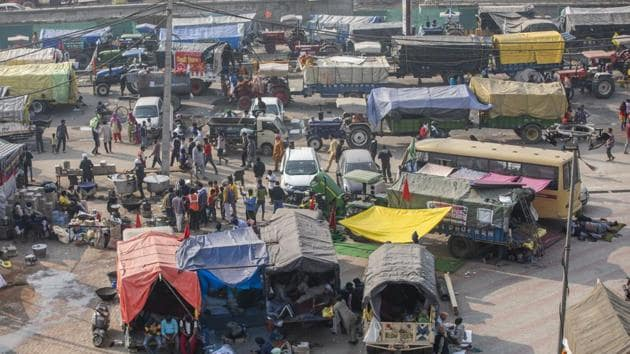 Tractors and trucks of protesting farmers at a protest site at a road block on the Delhi-Haryana border crossing in Singhu, Delhi, India, on Thursday.(Bloomberg Photo)