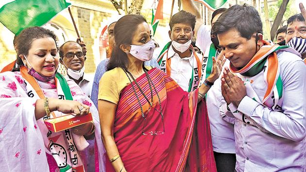 NCP leader Supriya Sule along with its party workers celebrate after the final results of graduate seats in Maharashtra, outside Rashtravadhi Bhavan in Ballard Estate, on Friday.(Anshuman Poyrekar/ HT)