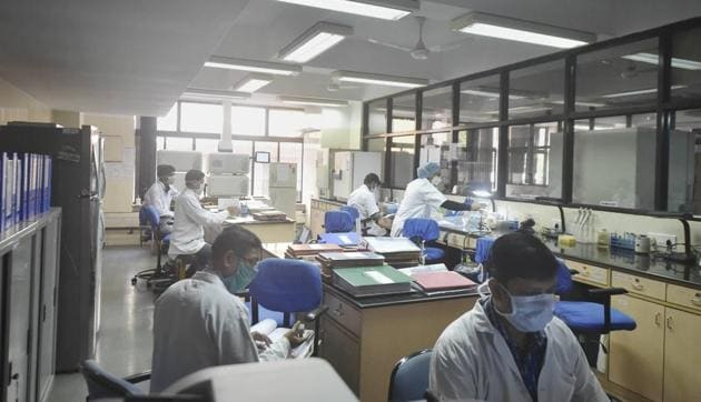 Scientists at work at a Covaxin trial site of ICMR-NICED during phase-III regulatory trial of the Covid-19 vaccine candidate, in Kolkata.(PTI)