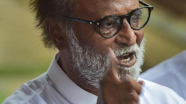 Actor-turned-politician Rajinikanth gestures as he addresses a press conference to announce the launch of his political party in January 2021, in Chennai.(PTI)