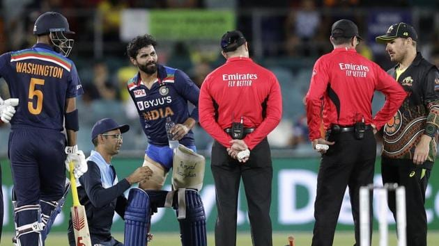 India's Ravindra Jadeja, third left, has a trainer tend to his leg during a break in batting against Australia during their T20 international cricket match at Manuka Oval, in Canberra.(AP)