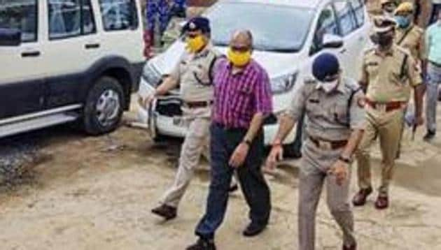 The Special Investigation Team during a visit to Bikru village, where eight policemen were killed by gangster Vikas Dubey on July 3.(PTI FILE PHOTO)