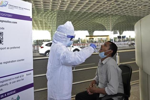 A health care worker during a Covid-19 screening drive at Chhatrapati Shivaji Maharaj International Airport in Mumbai.(Satyabrata Tripathy/HT File Photo)