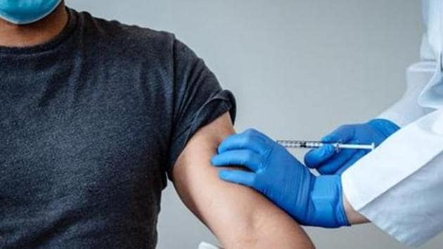 A person gets a dose of the coronavirus disease (COVID-19) vaccination of BioNTech and Pfizer in Mainz, Germany.(Reuters)