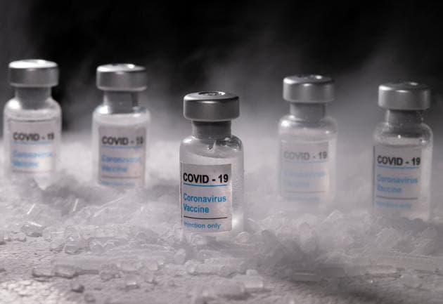"""Vials labelled """"Covid-19 Coronavirus Vaccine"""" are placed on dry ice in this illustration taken, December 4, 2020. Picture taken December 4, 2020.(REUTERS)"""