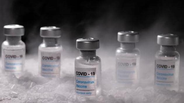"""Vials labelled """"COVID-19 Coronavirus Vaccine"""" are placed on dry ice in this illustration taken, December 4, 2020. Picture taken December 4, 2020. REUTERS/Dado Ruvic/Illustration(Reuters)"""