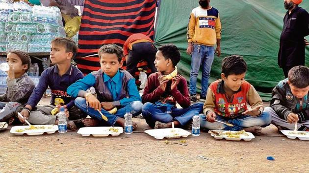 Children from nearby shanties enjoy a meal at the Singhu border (Delhi-Haryana border).(Sourced)