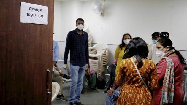 People wait during the administration of Covaxin, an Indian government-backed experimental Covid-19 vaccine, during its human trials, at the Gujarat Medical Education & Research Society in Ahmedabad.(PTI)