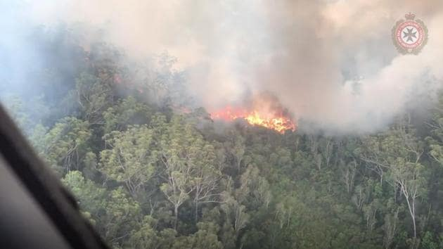 An aerial view shows bushfires on Fraser Island, Queensland, Australia, in this still image taken from video released on December 2, 2020.(Reuters)