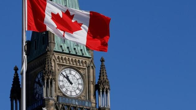 A Canada flag flies in front of the Peace Tower on Parliament Hill in Ottawa, Ontario.(REUTERS/ FILE)