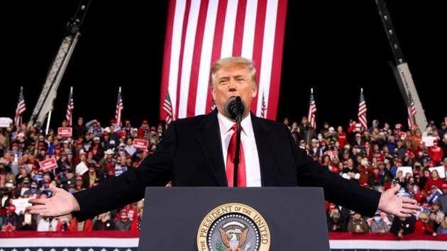 US President Donald Trump gestures as he speaks during a campaign rally for Republican US senators David Perdue and Kelly Loeffler, ahead of their January runoff elections to determine control of the US Senate, in Valdosta, Georgia, US on December 5, 2020.(Reuters File Photo)