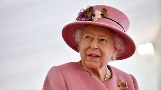 Britain's Queen Elizabeth speaks with staff during a visit to the Defence Science and Technology Laboratory at Porton Science Park near Salisbury on October 15.(Reuters file)