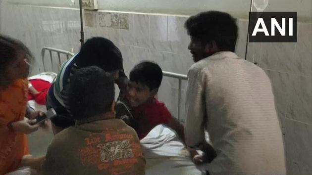 A patient is brought to a hospital on Sunday after hundreds took ill in Eluru town in Andhra Pradesh's West Godavari district with complaints of giddiness and epilepsy.(ANI Photo)