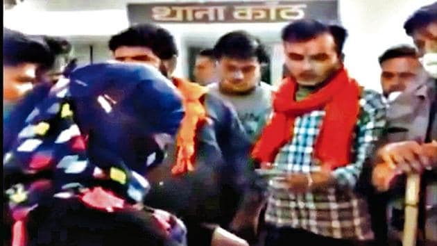 A one-minute video circulating on social media shows the activists of the Hindu organisation Bajrang Dal, with saffron scarves around their necks, questioning the woman in the presence of policemen inside the police station.(Screengrab)