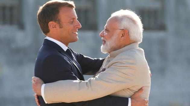 French President Emmanuel Macron welcomes Prime Minister Narendra Modi before a meeting at the Chateau of Chantilly, near Paris, France in August 2019(REUTERS)
