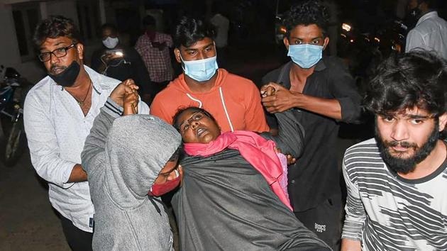 A woman showing symptoms of epilepsy being taken to a hospital in Eluru town of Andhra Pradesh Sunday night.(PTI)