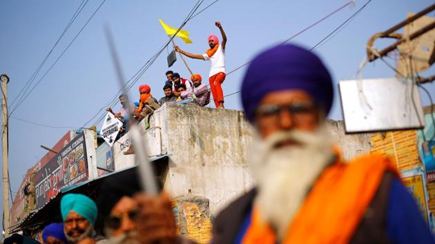 Farmers attend a protest against the newly passed farm bills at Singhu border near New Delhi.(REUTERS)