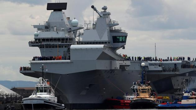 HMS Queen Elizabeth. The 65,000-tonne HMS Queen Elizabeth, which can carry up to 40 aircraft, was commissioned in late 2017 but next year's deployment will mark its maiden voyage in international waters.(Reuters)