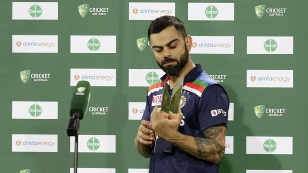 India's captain Virat Kohli holds the winners trophy at the end of the third T20 international cricket match between Australia and India at the Sydney Cricket Ground in Sydney, Australia, Tuesday, Dec. 8, 2020. Indian won the series 2-1. (AP Photo/Rick Rycroft)(AP)
