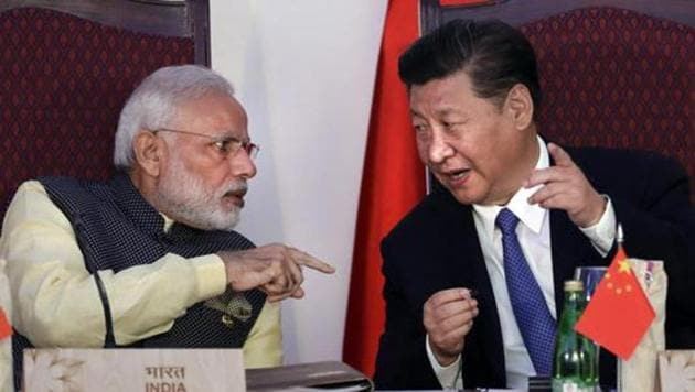 In this October 16, 2016, file photo, Indian Prime Minister Narendra Modi talks with Chinese President Xi Jinping at the signing ceremony by foreign ministers during the BRICS summit in Goa, India.(AP file)