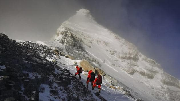 In this May 27 photo, members of a Chinese surveying team head for the summit of Mount Everest, also known locally as Mt. Qomolangma.(AP file)