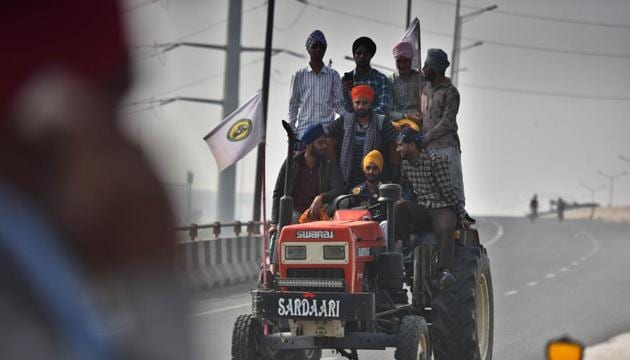 Farmers arrive at Ghazipur border on a tractor to join protest against farm reform laws, in New Delhi, India, on Monday, December 7, 2020. (Photo by Raj K Raj/ Hindustan Times)