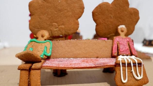 Two gingerbread figures sitting apart on a bench to illustrate social distancing are seen during the annual gingerbread baking competition at Arkdes Museum of Architecture and Design in Stockholm, Sweden December 7, 2020. Due to the coronavirus disease (COVID-19) outbreak the competition has moved online.(REUTERS)