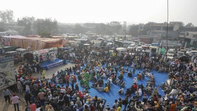 Farmers protest blocking a highway at the Singhu border between Delhi and Haryana on December 7, 2020.(AP Photo)