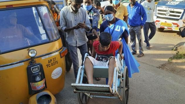 A young patient is brought in a wheelchair to the district government hospital in Eluru. More than 500 have been hospitalized due to an unidentified illness in this town.(AP)