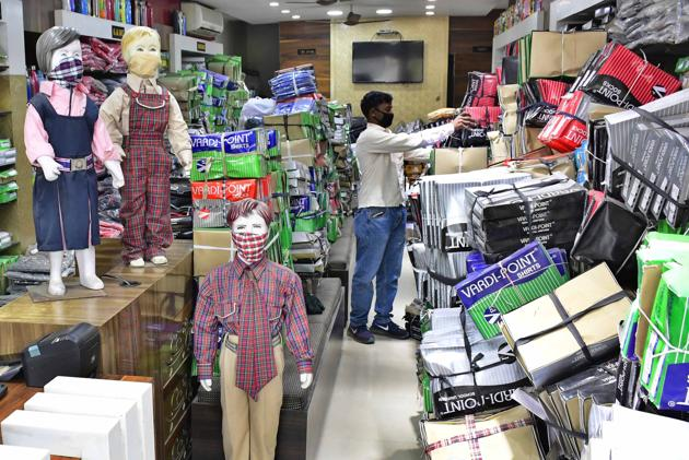 Many sellers and dealers of school uniforms said that they have not placed new orders as unsold stock has piled up at their stores.(Harsimar Pal SIngh/HT)