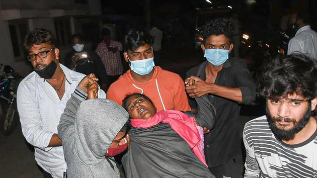 A woman showing symptoms of epilepsy being taken to a hospital in Eluru town of West Godavari district on December 6.(PTI)