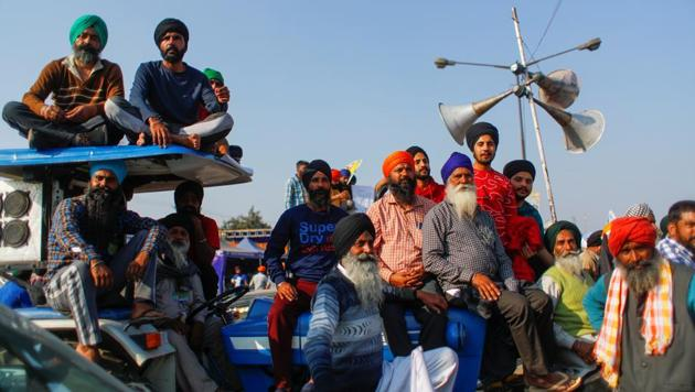 Farmers sit on a tractor as they listen to a speaker during a protest against the newly passed farm bills at Singhu border near New Delhi, India, December 9, 2020.(Reuters photo)