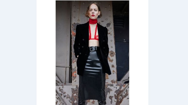 A boudoir-inspired bralette layered over an evening jacket and a PVC skirt from Saint Laurent by Anthony Vaccarello(Photo: Instagram/Saint Laurent)