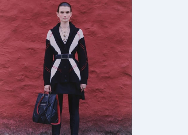 At Alexander McQueen, designer Sarah Burton created a graphic argyle cardigan dress by piecing together two jumpers(INSTAGRAM)
