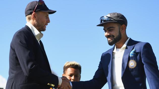 Joe Root of England shakes hands with Virat Kohli of India.(Getty Images)