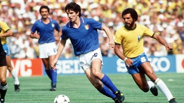 1982 FIFA World Cup: Italy's Paolo Rossi gets away from Brazil's Junior.(Action Images)
