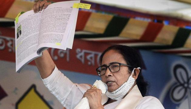 West Bengal chief minister Mamata Banerjee addresses a public rally, at Bongaon in North 24 Parganas district, on December 9.(PTI)